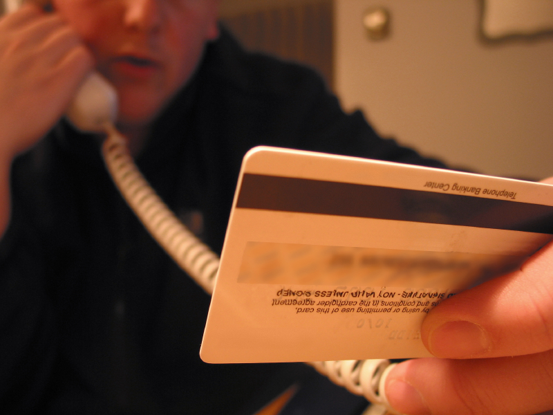 a man holds a credit card