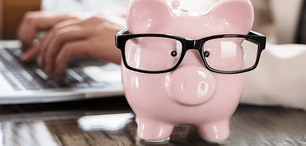 Piggy bank sporting glasses